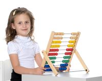 The girl counts on abacus Stock Images