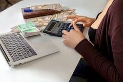 Girl counts money Stock Image