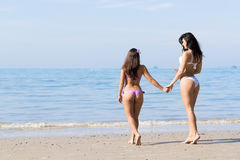 Girl Couple On Beach Summer Vacation, Young Woman Walking Holding Hands Royalty Free Stock Image