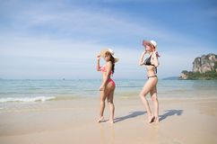 Girl Couple On Beach Summer Vacation, Young Woman Wear Hat Sea Ocean. Holiday Travel Stock Photos