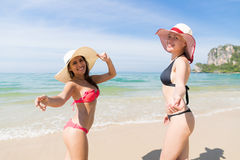Girl Couple On Beach Summer Vacation, Young Woman Wear Hat Sea Ocean. Holiday Travel Stock Photography