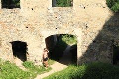 Girl on courtyard of castle Girls Stone stock image