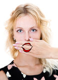 Girl cover her mouth with hand. Silence Stock Photos