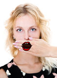 Girl cover her mouth with hand. Silence Stock Images