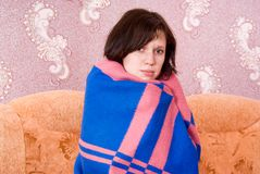 Girl is covered with a blanket Royalty Free Stock Photo