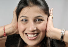 Girl with covered ears Stock Photos