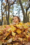 Girl covered with leaves Royalty Free Stock Image