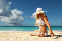 Girl covered with sand Stock Image