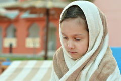Girl covered with towel Royalty Free Stock Images