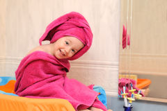 Girl covered in a towel after a swim Stock Photos