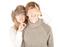 Girl covering boyfriend's eyes, keeping silent Royalty Free Stock Image