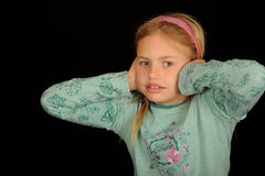 Girl covering ears Royalty Free Stock Photography