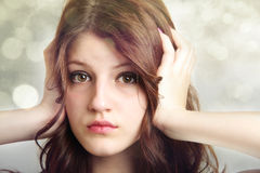 Girl covering ears not listening Stock Photos
