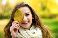 Girl covering eye with leaf Stock Photos