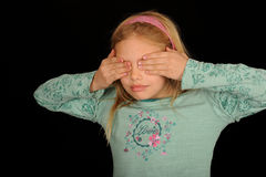 Girl covering eyes Stock Photo