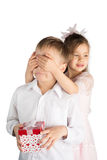 Girl Covering Eyes of The Boy Stock Photo