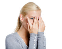 Girl covering eyes with hands Stock Photo