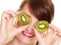 Girl covering eyes with kiwi tropical fruit Stock Photography