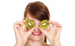 Girl covering eyes with kiwi tropical fruit Royalty Free Stock Photography