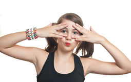 Girl covering eyes and peeping through her fingers Royalty Free Stock Photos