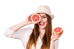 Girl covering eyes with two halfs of grapefruit citrus fruit Stock Image
