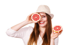 Girl covering eyes with two halfs of grapefruit citrus fruit Stock Photography