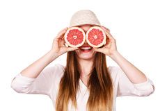 Girl covering eyes with two halfs of grapefruit citrus fruit Royalty Free Stock Photography