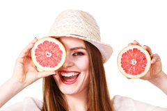 Girl covering eyes with two halfs of grapefruit citrus fruit Royalty Free Stock Photo