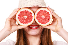 Girl covering eyes with two halfs of grapefruit citrus fruit Stock Photos