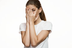 Girl covering face with hands, hiding face with hands Royalty Free Stock Photos
