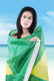 Girl covering her body with Brazilian flag Stock Photos