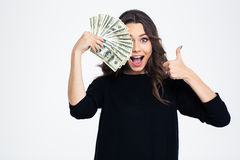 Girl covering her eye with dollar bills Stock Photography