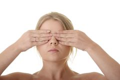Girl covering her eyes. Blind concept stock photo