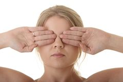 Girl covering her eyes. Blind concept royalty free stock image