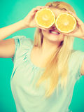 Girl covering her eyes with grapefruits Stock Photos