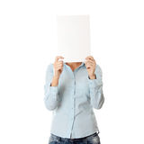 Girl covering her face with blank board Royalty Free Stock Photos