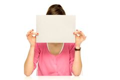 Girl covering her face with blank board Royalty Free Stock Image