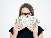 Girl covering her face with doll bills i Stock Photo