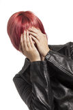Girl covering her face with her hands Stock Photo