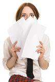 Girl covering her face with paper Stock Photos