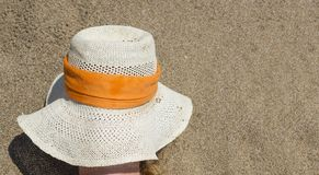 Girl covering her face with straw hat to protect herself from th Stock Image