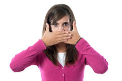 Girl covering her mouth Stock Images