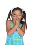 Girl covering her mouth Royalty Free Stock Photography