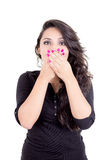 Girl covering her mouth with hands Stock Photo