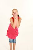 Girl covering mouth Stock Photography