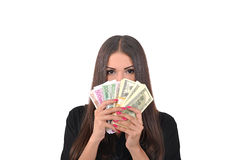 Girl covers her face with a fan of money Stock Image