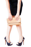 Girl covers her knees bag Stock Images