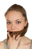 Girl covers her mouth with hair Royalty Free Stock Photo