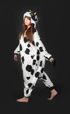Girl in a cow costume Stock Images