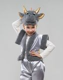 Girl in a cow costume shows the horns Royalty Free Stock Photography